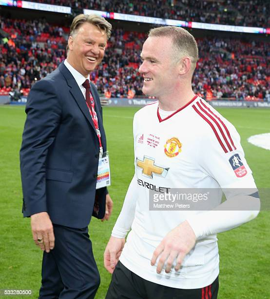 Manager Louis van Gaal and Wayne Rooney of Manchester United celebrate after The Emirates FA Cup final match between Manchester United and Crystal...
