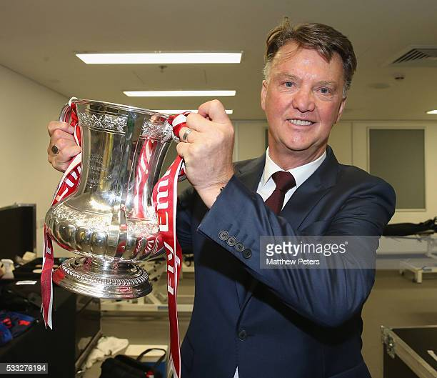 Manager Louis van Gaal of Manchester United celebrates in the dressing room with the FA Cup trophy after The Emirates FA Cup final match between...