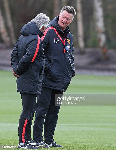 Manager Louis van Gaal of Manchester United chats during a first team training session at Aon Training Complex on December 11, 2014 in Manchester,...