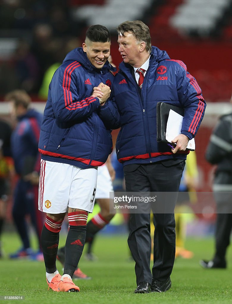 Manager Louis van Gaal of Manchester United congratulate Marcos Rojo after the Barclays Premier League match between Manchester United and Watford at Old Trafford on March 2, 2016 in Manchester, England.