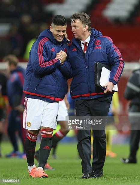 Manager Louis van Gaal of Manchester United congratulate Marcos Rojo after the Barclays Premier League match between Manchester United and Watford at...