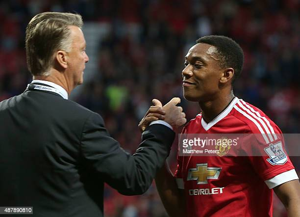 Manager Louis van Gaal of Manchester United congratulates Anthony Martial after the Barclays Premier League match between Manchester United and...