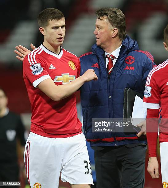 Manager Louis van Gaal of Manchester United congratulates Patrick McNair after the Barclays Premier League match between Manchester United and...