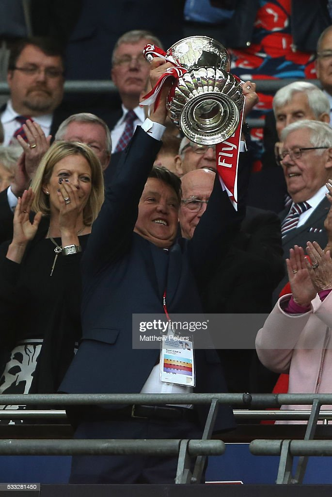 Manager Louis van Gaal of Manchester United lifts the FA Cup after The Emirates FA Cup final match between Manchester United and Crystal Palace at Wembley Stadium on May 21, 2016 in London, England.