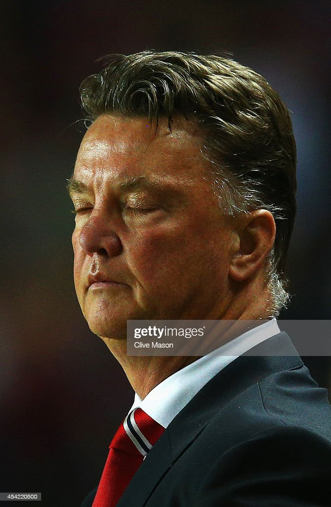 Manager Louis van Gaal of Manchester United looks dejected after the Capital One Cup Second Round match between MK Dons and Manchester United at Stadium mk on August 26, 2014 in Milton Keynes, England.