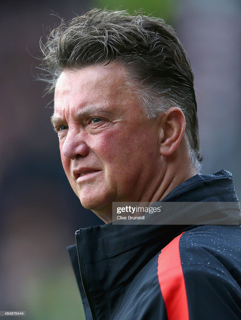 Manager Louis van Gaal of Manchester United looks on during the Barclays Premier League match between Burnley and Manchester United at Turf Moor on August 30, 2014 in Burnley, England.