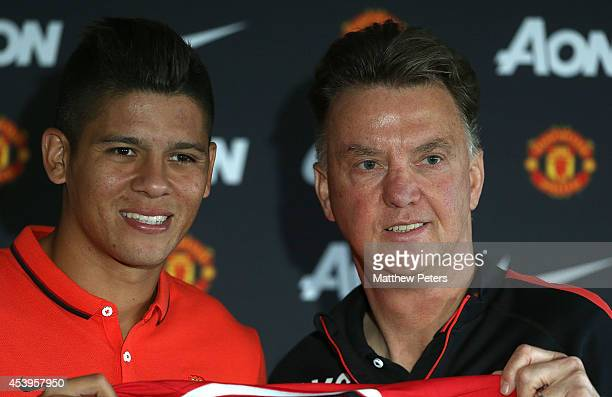 Manager Louis van Gaal of Manchester United poses with Marcos Rojo after a press conference to unveil new signing Marcos Rojo at Aon Training Complex...