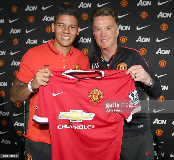 Manager Louis van Gaal of Manchester United poses with new signing Marcos Rojo after a press conference at Aon Training Complex on August 22 2014 in...