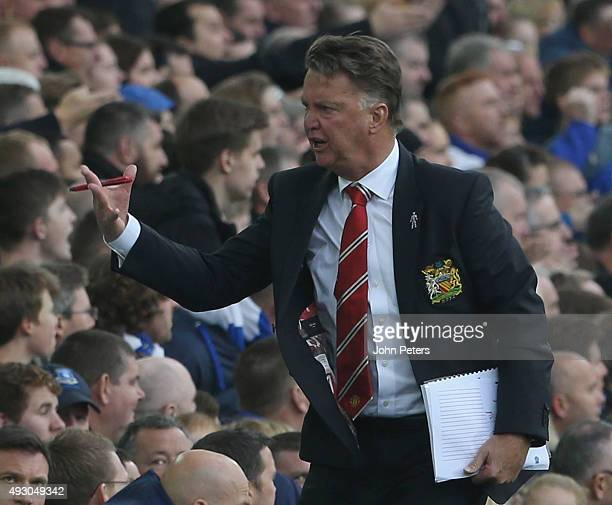 Manager Louis van Gaal of Manchester United shouts instructions from Tthe touchline during the Barclays Premier League match between Everton and...