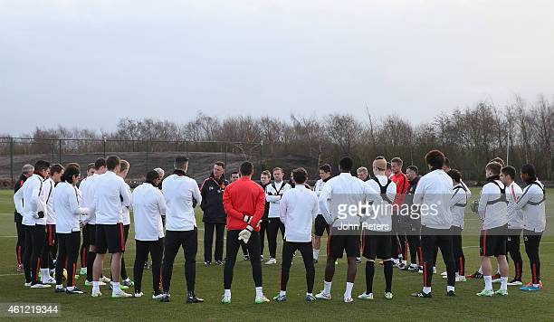 Manager Louis van Gaal of Manchester United speaks to the squad during a first team training session at Aon Training Complex on January 9 2015 in...