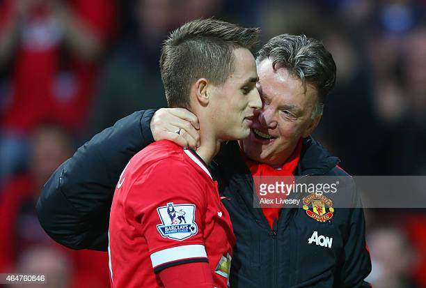 Manager Louis van Gaal of Manchester United speaks with Adnan Januzaj of Manchester United after the Barclays Premier League match between Manchester...