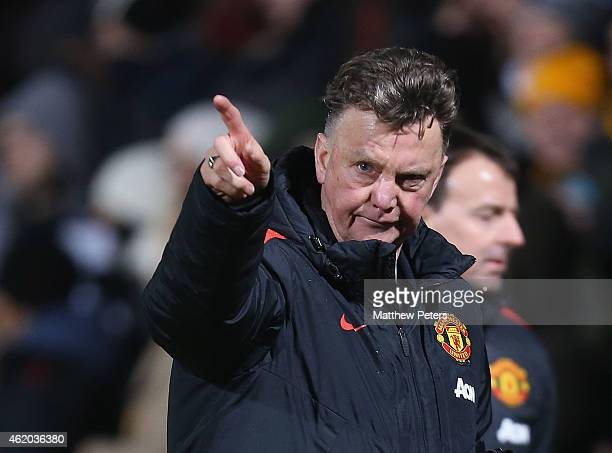 Manager Louis van Gaal of Manchester United walks off after the FA Cup Fourth Round match between Cambridge United and Manchester United at The R...