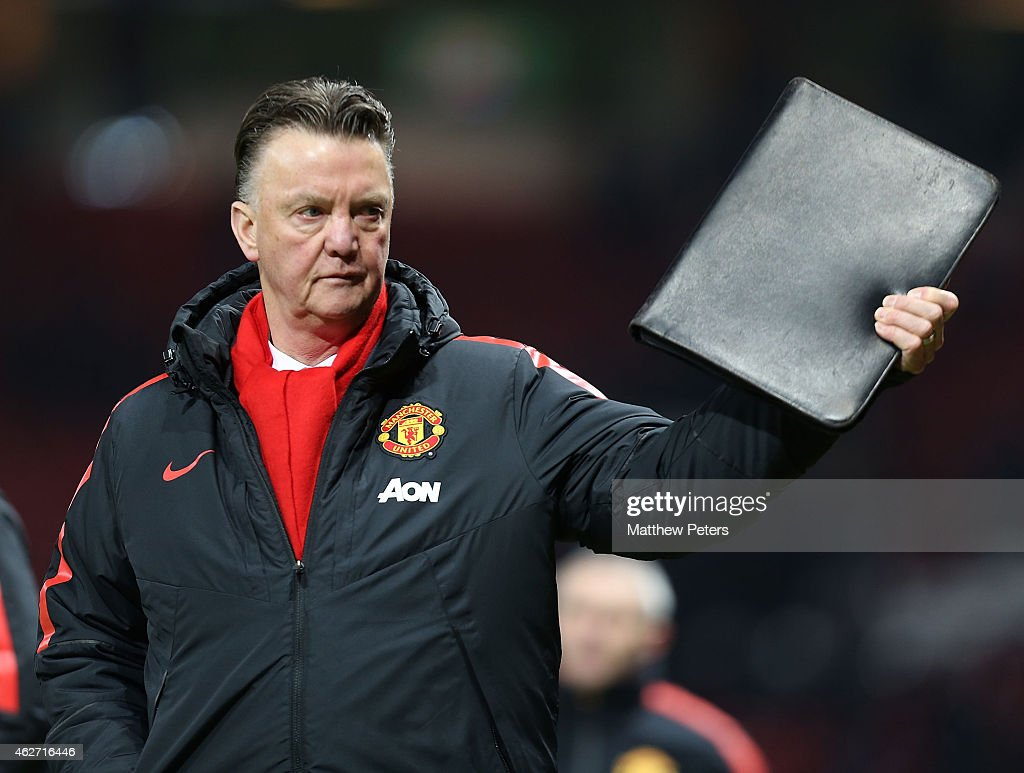 Manager Louis van Gaal of Manchester United walks off after the FA Cup Fourth Round replay match between Manchester United and Cambridge United at Old Trafford on February 3, 2015 in Manchester, England.