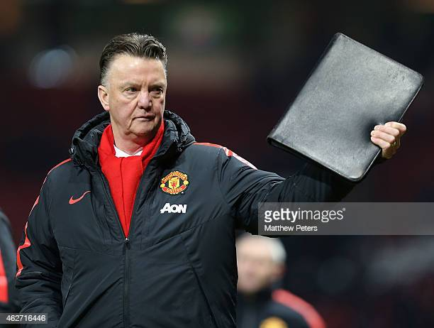 Manager Louis van Gaal of Manchester United walks off after the FA Cup Fourth Round replay match between Manchester United and Cambridge United at...