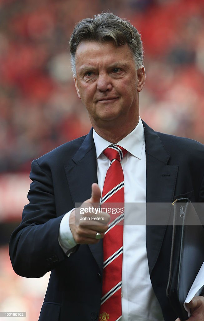 Manager Louis van Gaal of Manchester United walks off after the Barclays Premier League match between Manchester United and West Ham United at Old Trafford on September 27, 2014 in Manchester, England.