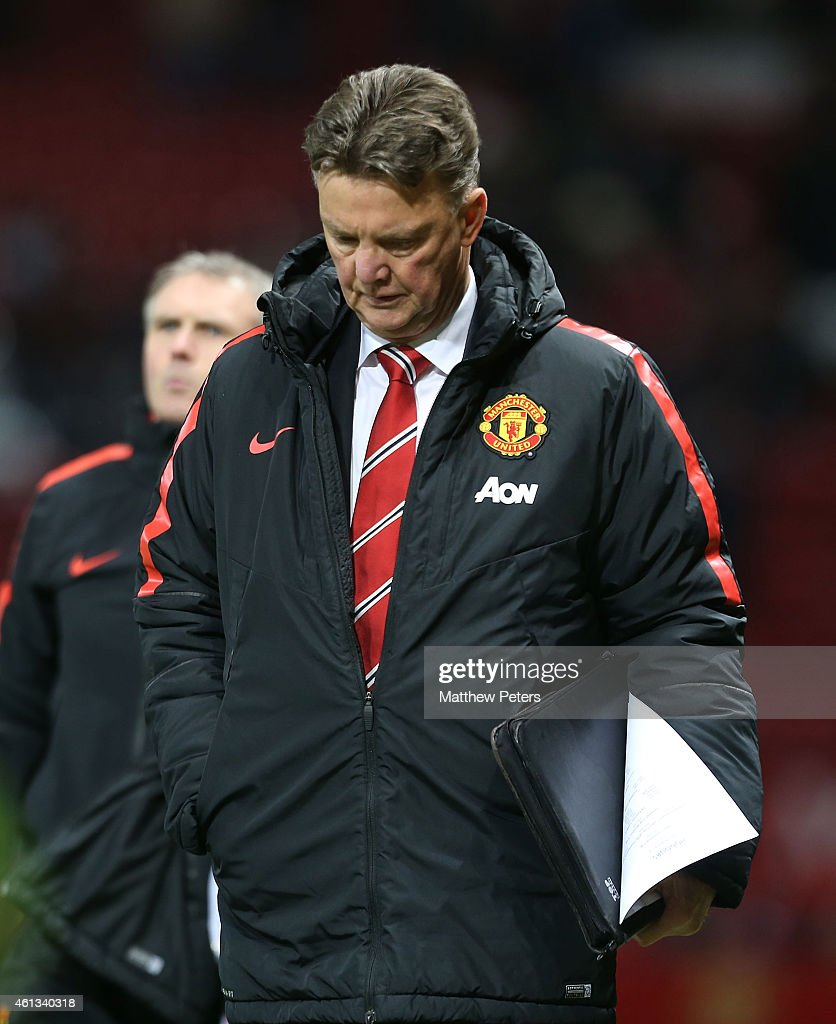 Manager Louis van Gaal of Manchester United walks off after the Barclays Premier League match between Manchester United and Southampton at Old Trafford on January 11, 2015 in Manchester, England.