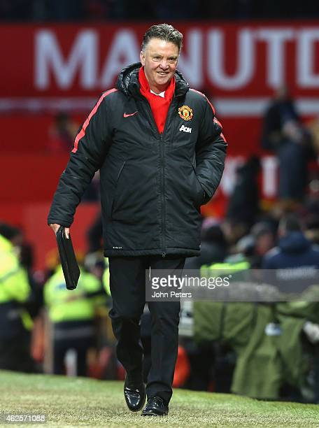 Manager Louis van Gaal of Manchester United walks off after the Barclays Premier League match between Manchester United and Leicester City at Old...