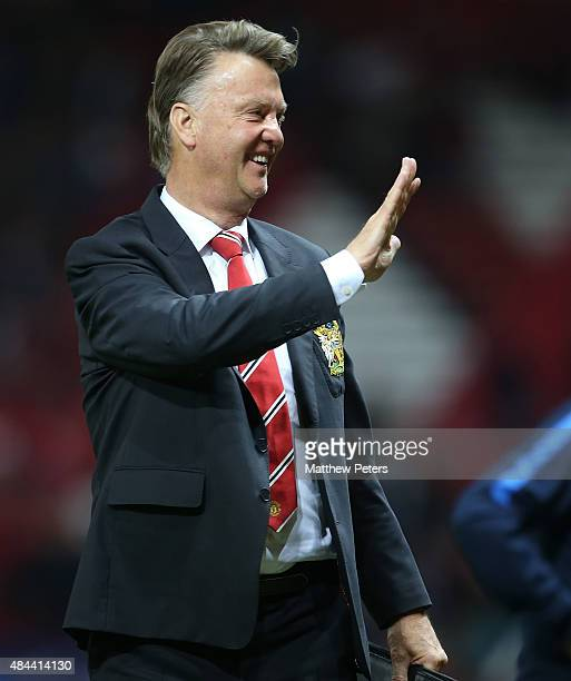 Manager Louis van Gaal of Manchester United walks off after the UEFA Champions League playoff first leg match between Manchester United and Club...