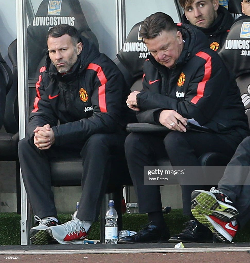 Manager Louis van Gaal of Manchester United watches from the dugout during the Barclays Premier League match between Swansea City and Manchester United at Liberty Stadium on February 21, 2015 in Swansea, Wales.