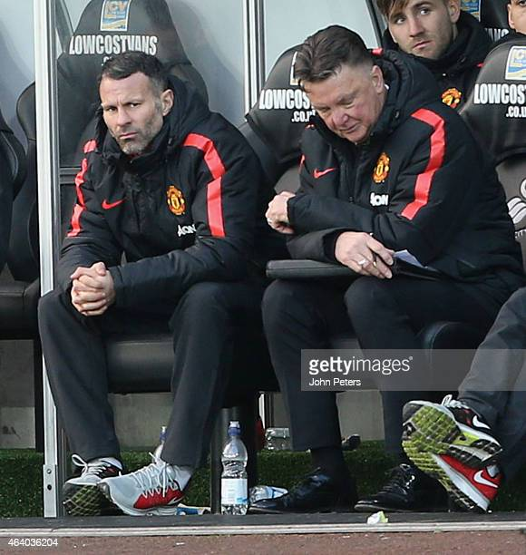 Manager Louis van Gaal of Manchester United watches from the dugout during the Barclays Premier League match between Swansea City and Manchester...