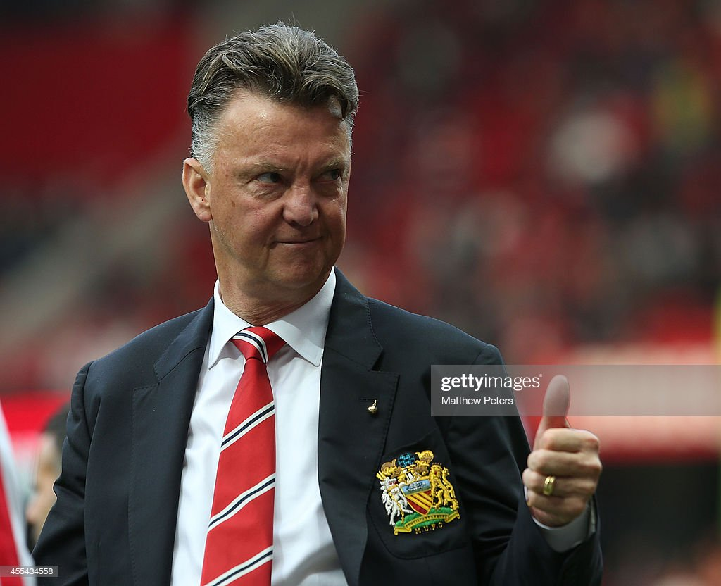 Manager Louis van Gaal of Manchester United waves to the crowd after the Barclays Premier League match between Manchester United and Queens Park Rangers at Old Trafford on September 14, 2014 in Manchester, England.