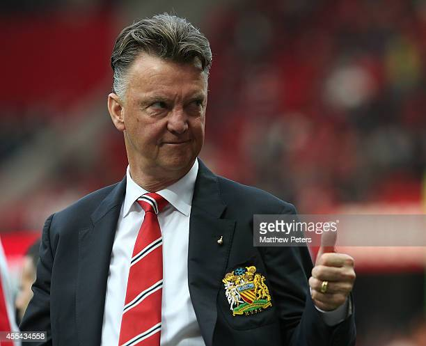 Manager Louis van Gaal of Manchester United waves to the crowd after the Barclays Premier League match between Manchester United and Queens Park...