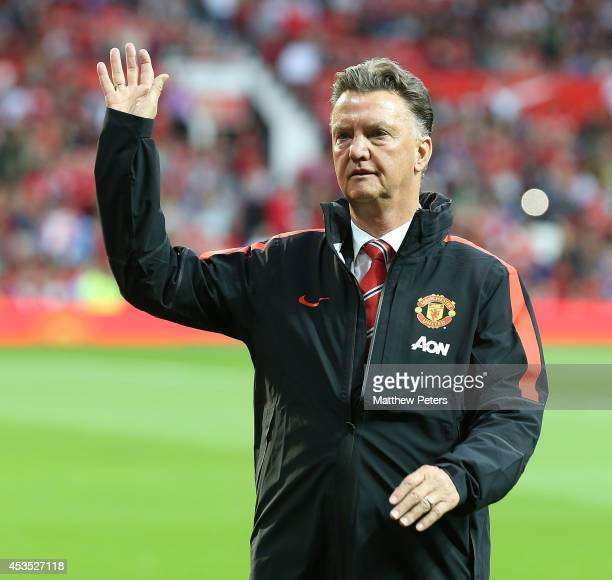 Manager Louis van Gaal of Manchester United waves to the crowd ahead of the Pre Season Friendly match between Manchester United and Valencia at Old...