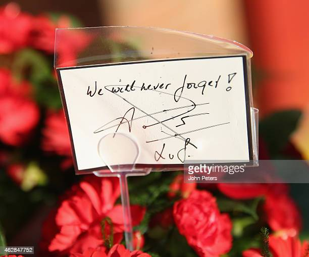 Manager Louis van Gaal of Manchester United's handwritten message on a wreath laid at the Munich Air Disaster memorial to remember the 21 people...