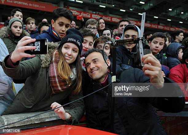 Manager Luis Enrique of FC Barcelona is photographed with a Sporting fan prior to the the La Liga match between Sporting Gijon and FC Barcelona at...