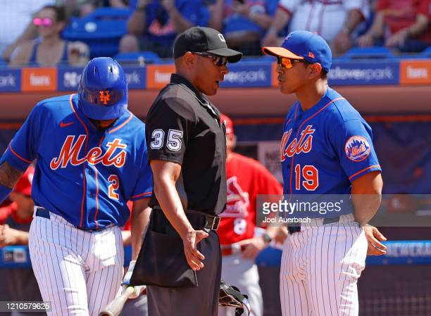 Manager Luis Rojas of the New York Mets argues the strike call against Dominic Smith with home plate umpire Jeremie Rehab during first inning action...