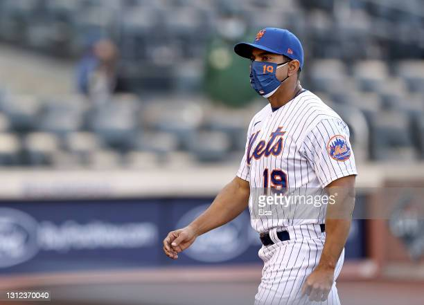 Manager Luis Rojas of the New York Mets heads back to the dugout after he pulled starting pitcher Taijuan Walker from the game in the fifth inning...