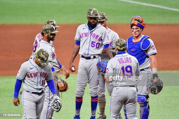Manager Luis Rojas of the New York Mets removes pitcher David Peterson from the game in the eighth inning against the Tampa Bay Rays at Tropicana...