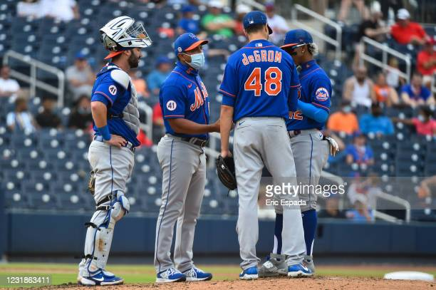 Manager Luis Rojas of the New York Mets takes out Jacob deGrom during the fifth inning of a spring training game against the Washington Nationals at...