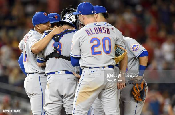 Manager Luis Rojas of the New York Mets talks to his players in the ninth inning against the Washington Nationals at Nationals Park on June 18, 2021...