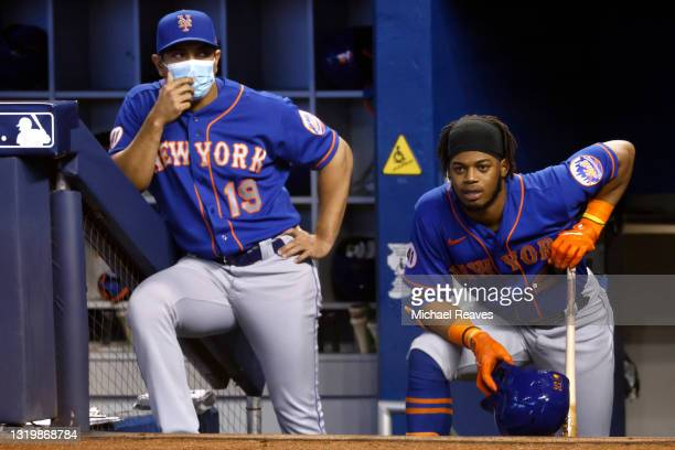 Manager Luis Rojas of the New York Mets talks with Khalil Lee against the Miami Marlins during the first inning at loanDepot park on May 23, 2021 in...
