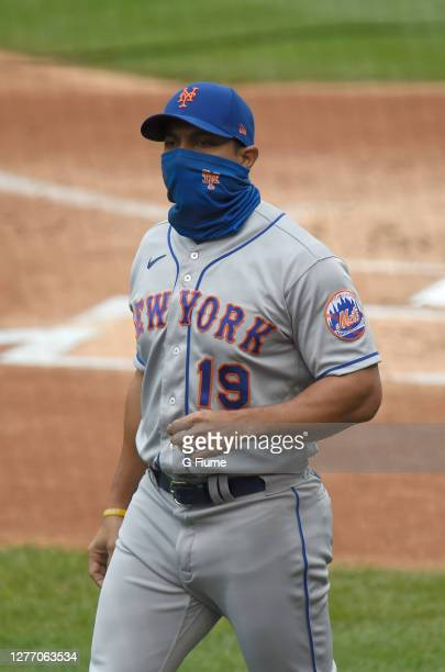 Manager Luis Rojas of the New York Mets walks to the dugout against the Washington Nationals during game 1 of a double header at Nationals Park on...
