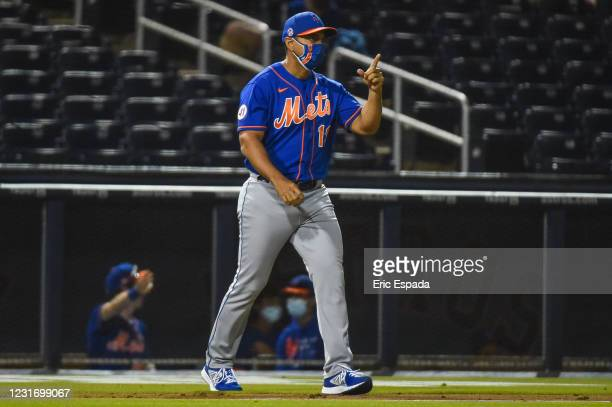 Manager Luis Rojas of the New York Mets walks towards the pitchers mound to make a pitching change during the Spring Training game against the...