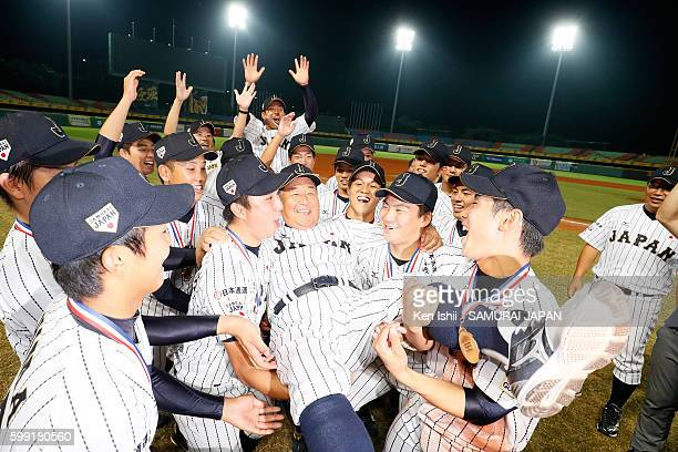 Manager Mamoru Koeda of Japan is congratulated by players after the final game between Japan and Taiwan during the 11th BFA U18 Baseball Championship...