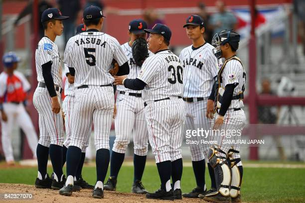 Manager Mamoru Koeda of Japan speaks with his team during the sixth inning of a game against Cuba during the WBSC U18 Baseball World Cup Group B game...