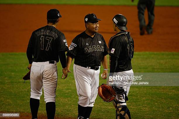 Manager Mamoru Koeda talks in the bottom half of the eighth inning in the semifinal round game between South Korea and Japan during the 11th BFA U18...