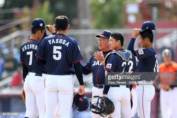 Manager Mamuro Koeda of Japan speaks to his team during the fifth inning of a game against the Netherlands during the WBSC U18 Baseball World Cup...
