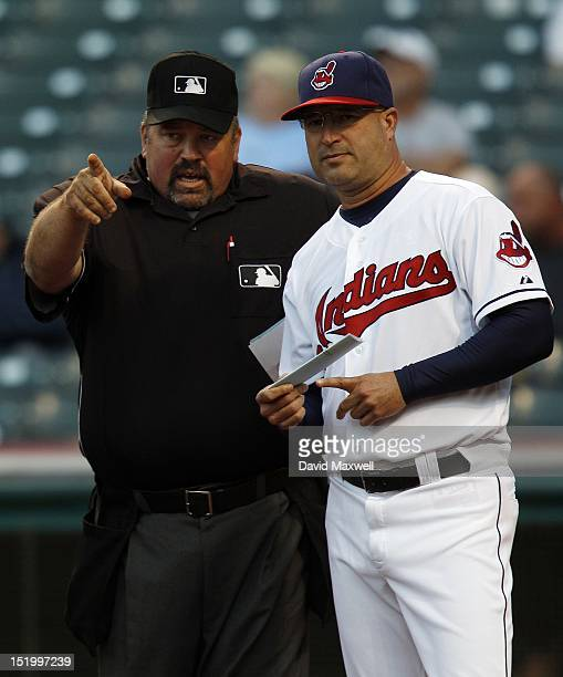 Manager Manny Acta of the Cleveland Indians talks with home plate umpire Wally Bell before the start of a game against the Detroit Tigers on...