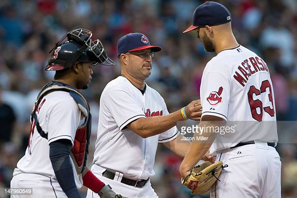 Manager Manny Acta takes starting pitcher Justin Masterson of the Cleveland Indians out of the game during the fifth inning against the Tampa Bay...