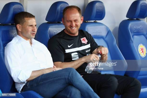 Manager Marc Arnold and head coach Torsten Lieberknecht of Braunschweig react prior to the Bundesliga Playoff leg 2 match between Eintracht...