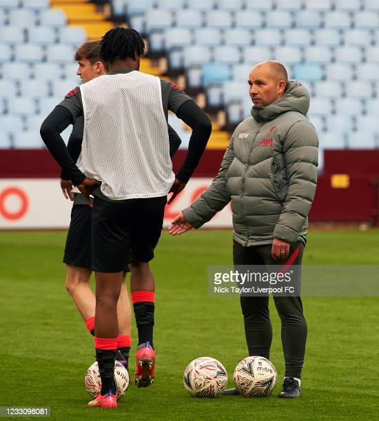 Manager Marc Bridge-Wilkinson of Liverpool talks to James Balagizi during the FA Youth Cup Final between Aston Villa U18 and Liverpool U18, at Villa...