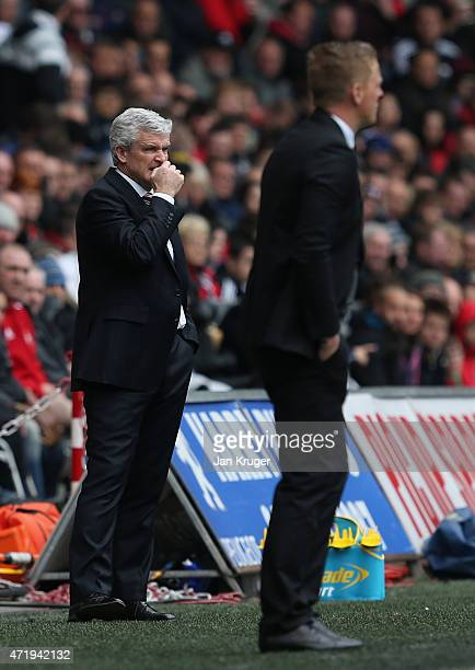 Manager Mark Hughes of Stoke City grimaces during the Barclays Premier League match between Swansea City and Stoke City at Liberty Stadium on May 2...