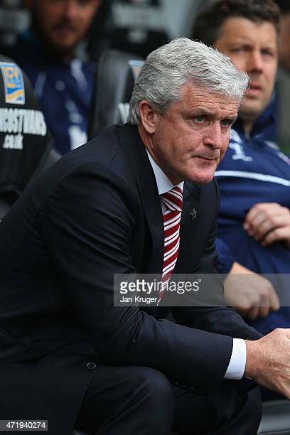 Manager Mark Hughes of Stoke City looks on during the Barclays Premier League match between Swansea City and Stoke City at Liberty Stadium on May 2...