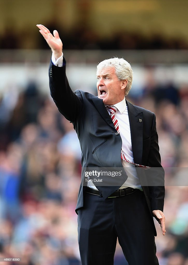 Manager Mark Hughes of Stoke City reacts during the Barclays Premier League match between West Ham United and Stoke City at Boleyn Ground on April 11, 2015 in London, England.
