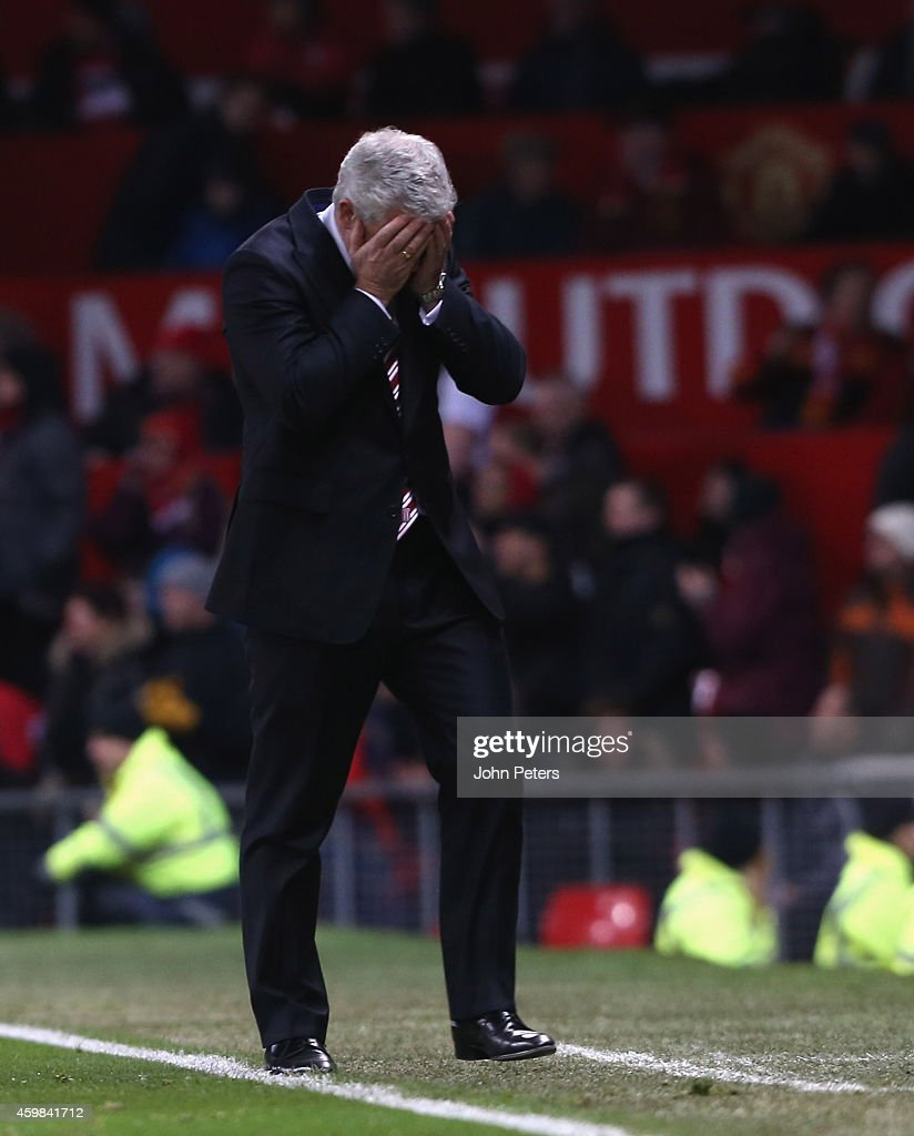 Manager Mark Hughes of Stoke City reacts to a missed chance during the Barclays Premier League match between Manchester United and Stoke City at Old Trafford on December 2, 2014 in Manchester, England.