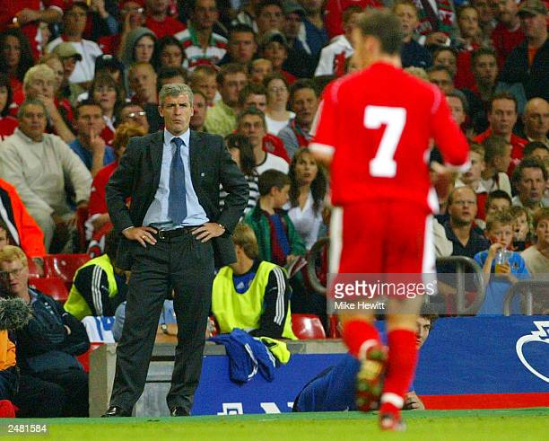 Manager Mark Hughes of Wales looks at Jason Koumas of Wales as he leaves the field after being sent off during the Euro 2004 Qualifier Group 9 match...